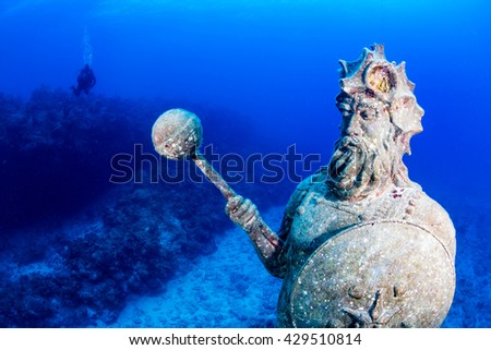 Underwater Statue with Background Scuba Diver - stock photo