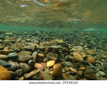 Underwater stones - Landa River, Sumatra, Indonesia - stock photo