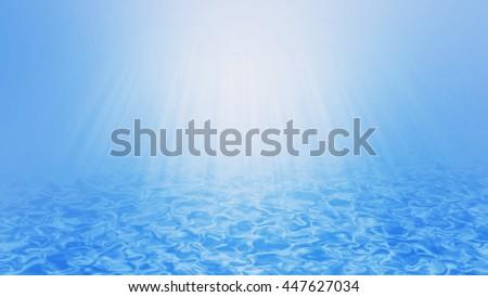 Underwater wave background with sun rays beam. - stock photo
