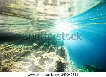 underwater world on wave background - stock photo