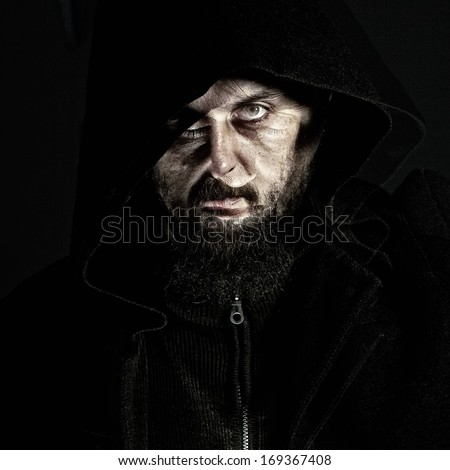 Unearthly dark portrait of mystery bearded man - double exposure - stock photo