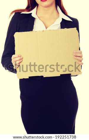 Unemployed businesswoman with empty cardboard sign - stock photo