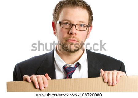 Unemployed - This is a photo of an unemployed businessman holding a cardboard sign with a worried look on his face. Shot on an isolated white background. - stock photo