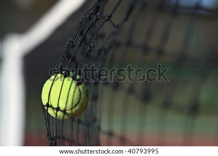Unenforced error - Tennis ball in the net - stock photo