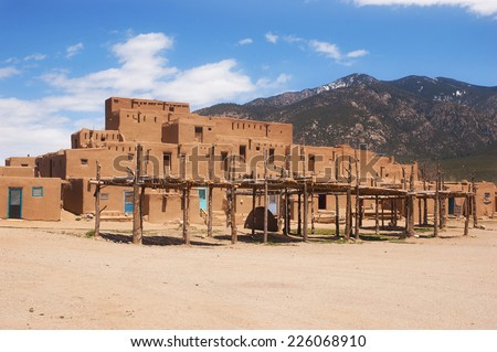 UNESCO World Heritage Site Taos Pueblo outside of Taos, New Mexico, continuously inhabited for over 1000 years. - stock photo