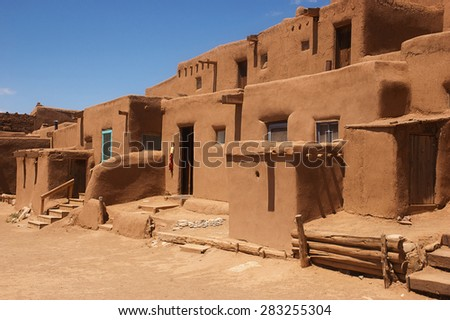 UNESCO World Heritage Site Taos Pueblo outside of Taos, New Mexico, continuously inhabited for over 1000 years - stock photo