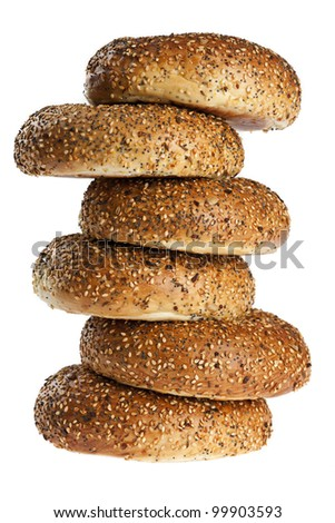uneven stack of half dozen freshly baked everything bagels isolated on white background
