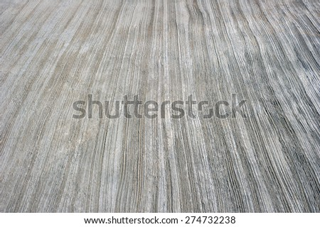 Uneven surfaces of cement are putty on the ground. - stock photo