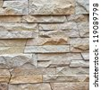 Uneven variety shape and texture of a stone wall for background - stock photo