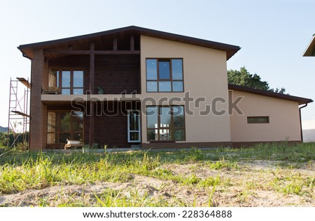 Unfinished Architectural Brown Real Estate Building Design on Grassy Landscape. - stock photo