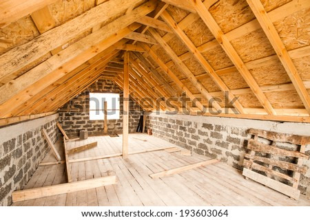 Unfinished attic floor of a private house - stock photo