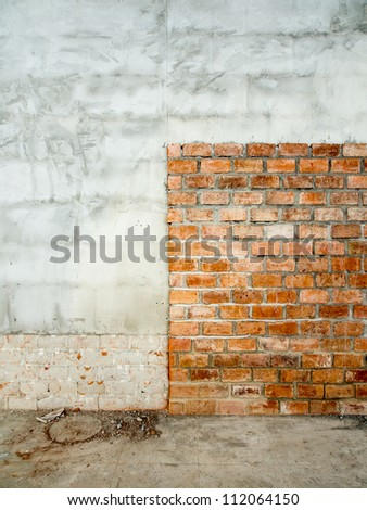 Unfinished brick wall in a building under decoration