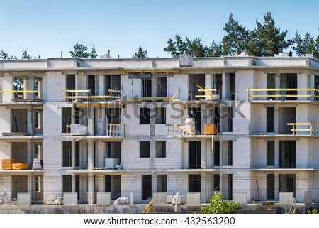 Unfinished building construction site. White bricks - stock photo
