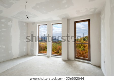Unfinished building interior, white room with autumn view (includes clipping path)