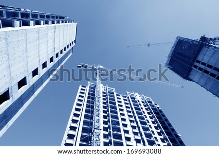 unfinished building under the blue sky, in China - stock photo