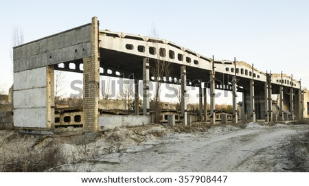 Unfinished construction of the industrial building. Concrete framework.