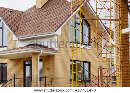 Unfinished european house of brick, still under construction. Building concept