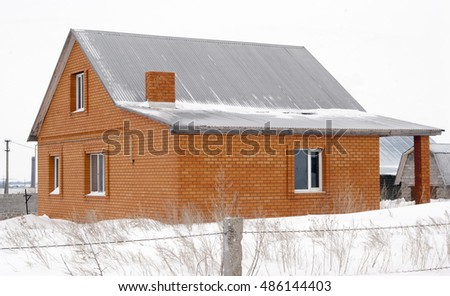 Unfinished house in the village, unit tunes snow