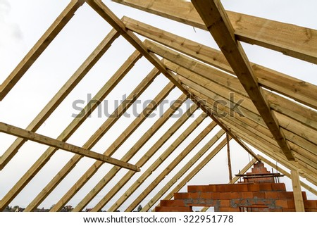 Unfinished house of brick, still under construction - stock photo