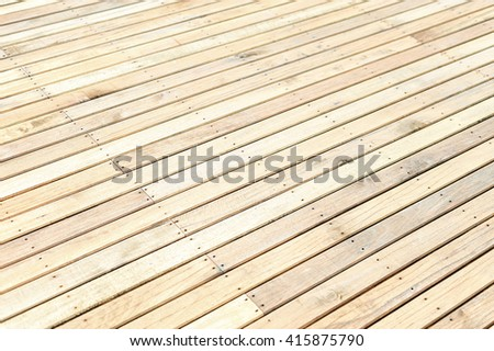 Unfinished new wooden floor at a construction site. Abstract background with copy space. Shallow depth of field.  - stock photo