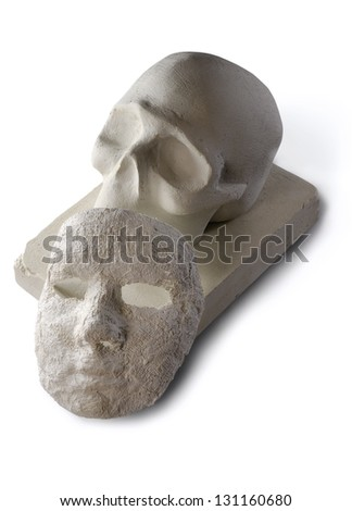 Unfinished sculpture made of white clay and paper - stock photo