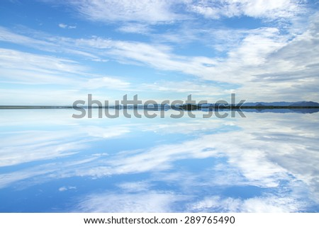 Unfocus miror of blue sky with white colud on the lake at Wildlife sanctuaries, southern Thailand. (Wetland) - stock photo