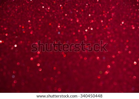 Unfocused abstract red glitter holiday background. Winter xmas holidays. Christmas. Valentine's day. - stock photo