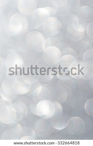 Unfocused abstract silver glitter holiday background. Winter xmas holidays. Christmas. - stock photo