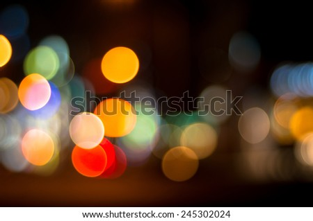 Unfocused, bokeh traffic and city lights at night - stock photo