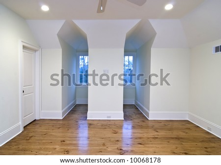 unfurnished upstairs bedroom with gable openings - stock photo