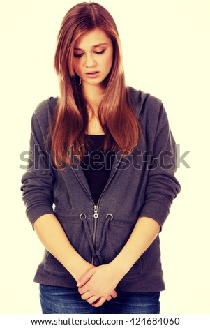 Unhappy and thoughtful teenage woman - stock photo