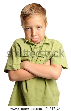 Unhappy Boy. Young boy making a pouty face. Isolated on white.