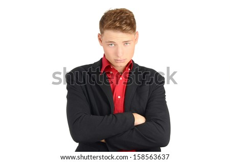 Unhappy business man with hands crossed. Isolated on white.