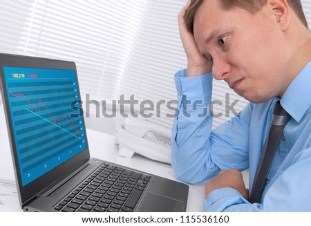 unhappy businessman with a laptop in office - stock photo