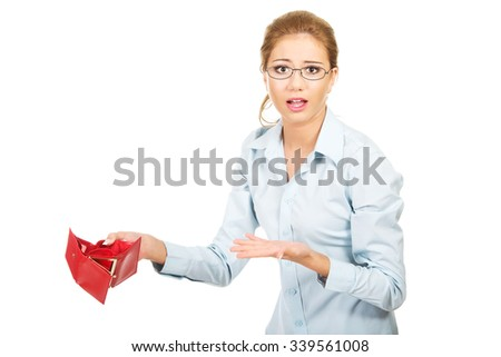 Unhappy businesswoman holding empty purse. - stock photo