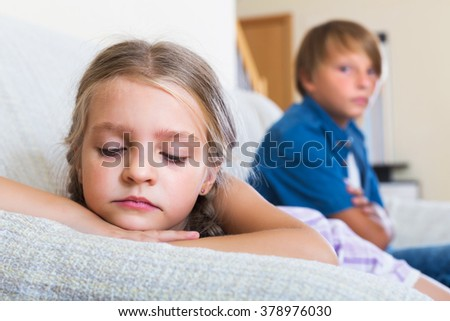 Unhappy children having serious fight in domestic interior