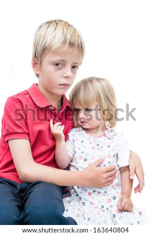 Unhappy Children, sister and brother. - stock photo