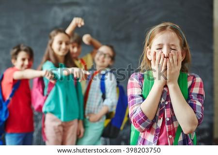 Unhappy classmate - stock photo