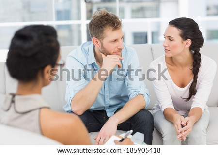 Unhappy couple at therapy session in therapists office - stock photo