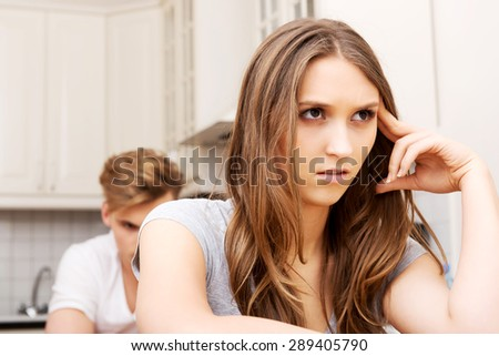 Unhappy couple having an argument in the kitchen at home. - stock photo