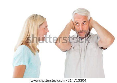 Unhappy couple having an argument with man not listening on white background - stock photo