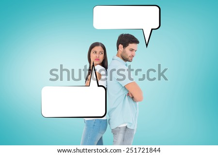 Unhappy couple not speaking to each other against blue vignette background - stock photo
