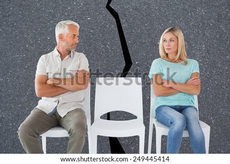 Unhappy couple not speaking to each other against road - stock photo
