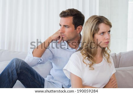 Unhappy couple not talking after an argument in living room at home - stock photo