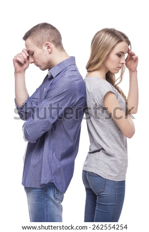 Unhappy couple standing back to back. isolated on white background. - stock photo