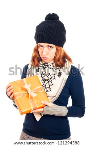 Unhappy disappointed sad woman holding gift box, isolated on white background. - stock photo