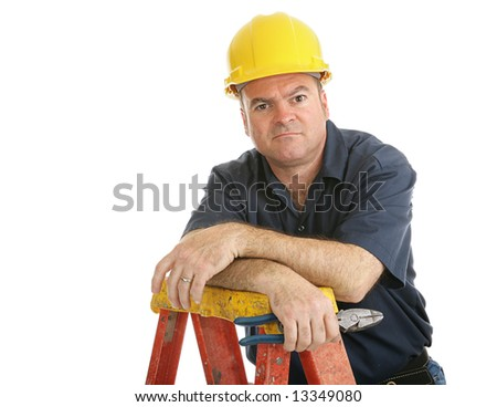 Unhappy, dissatisfied construction worker on a ladder.  Isolated on white. - stock photo
