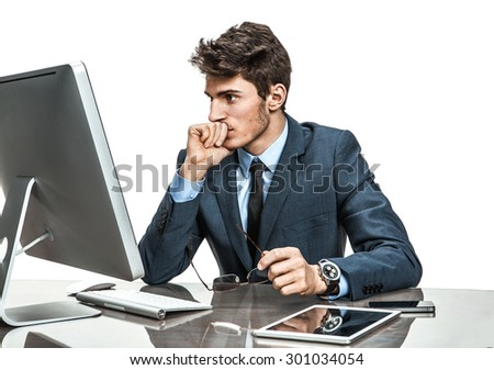 Unhappy entrepreneur dissatisfied with his profit, income, earnings, gain, benefit, margin / modern businessman at the workplace working with computer, depression and crisis concept - stock photo