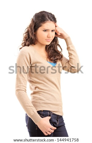 Unhappy female teenager posing isolated on white background