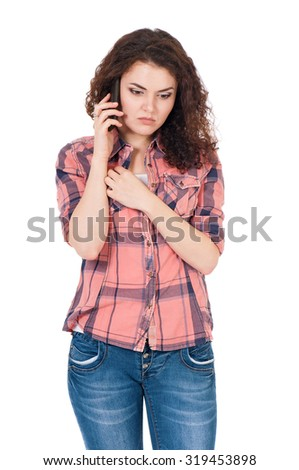 Unhappy girl with cellular telephone, isolated on white background - stock photo
